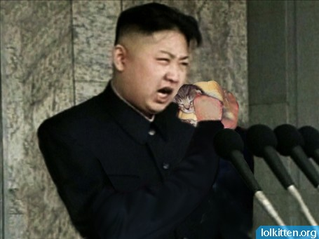 Kim Jong Un eating a cat sandwich.